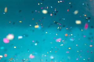Falling confetti on a blue background