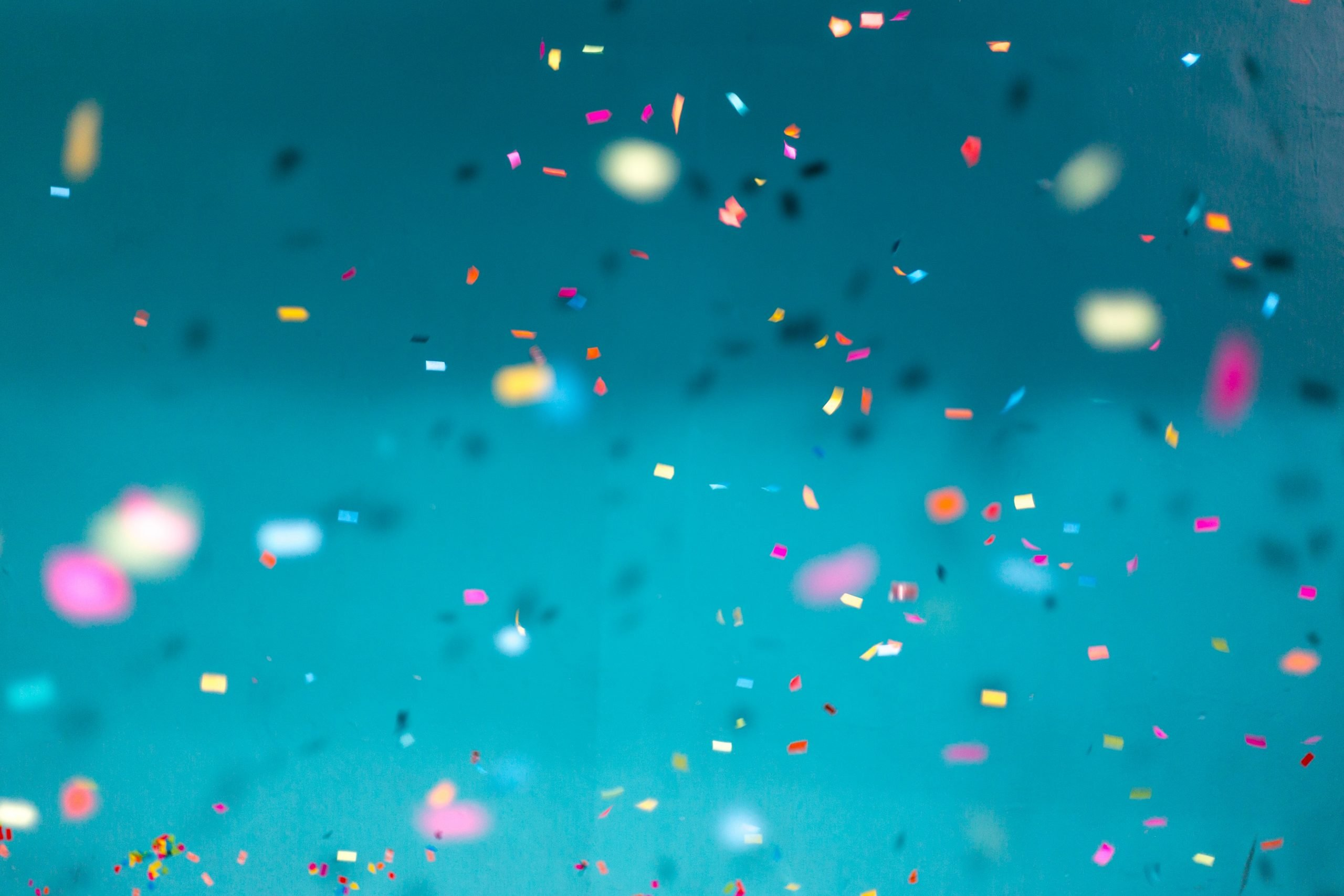 Falling confetti on a blue background