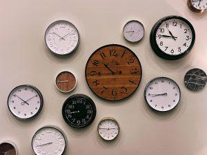 A variety of analog clocks