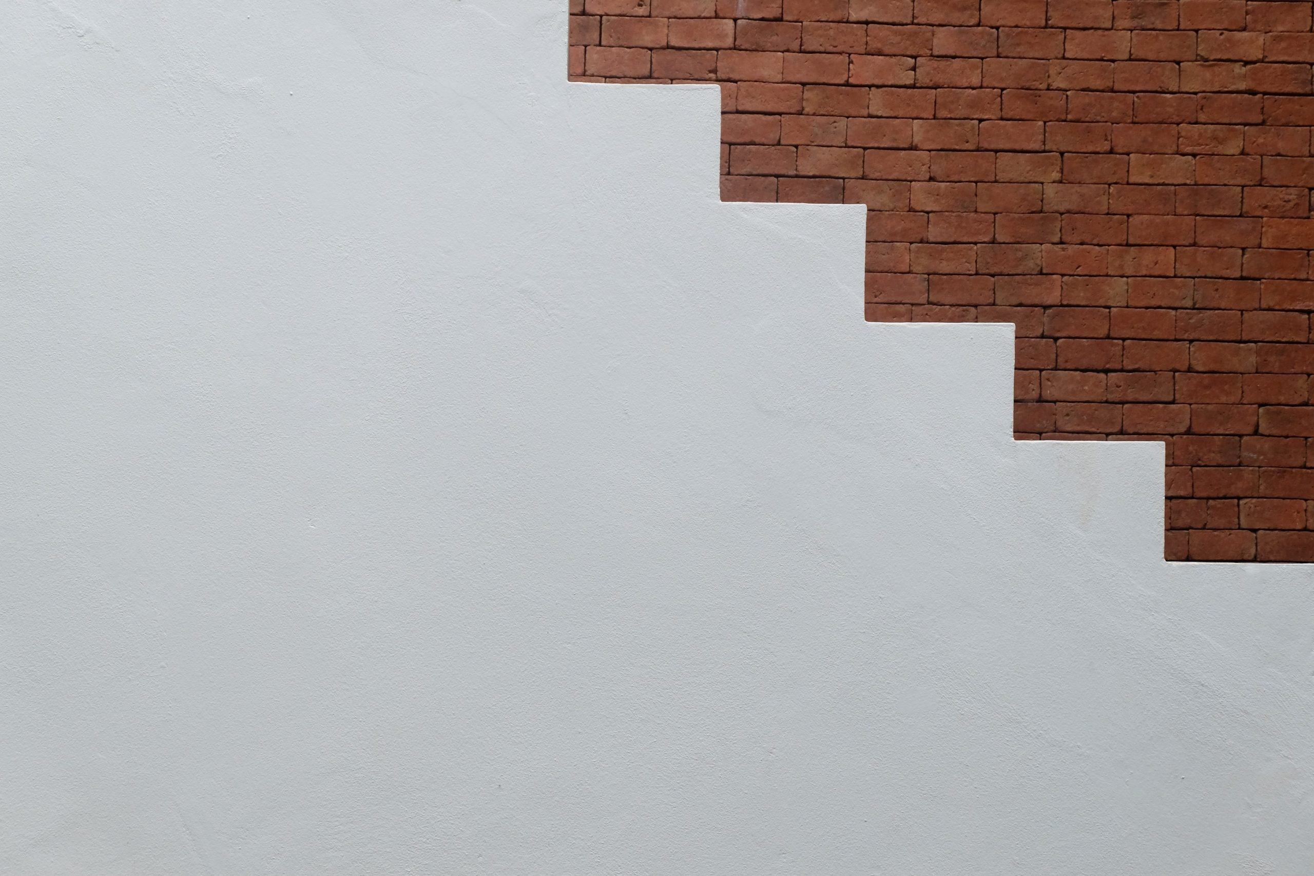 White concrete stairs with the brick background